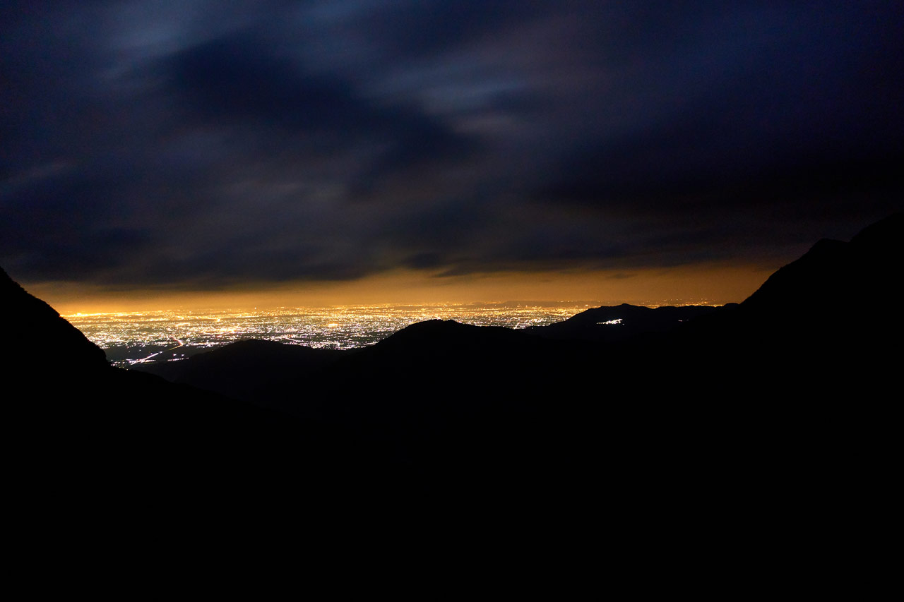 Looking at city at night from mountains far away