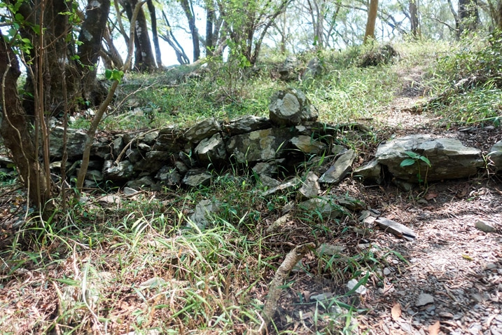 Trail leading up past many stacked stones at a low height