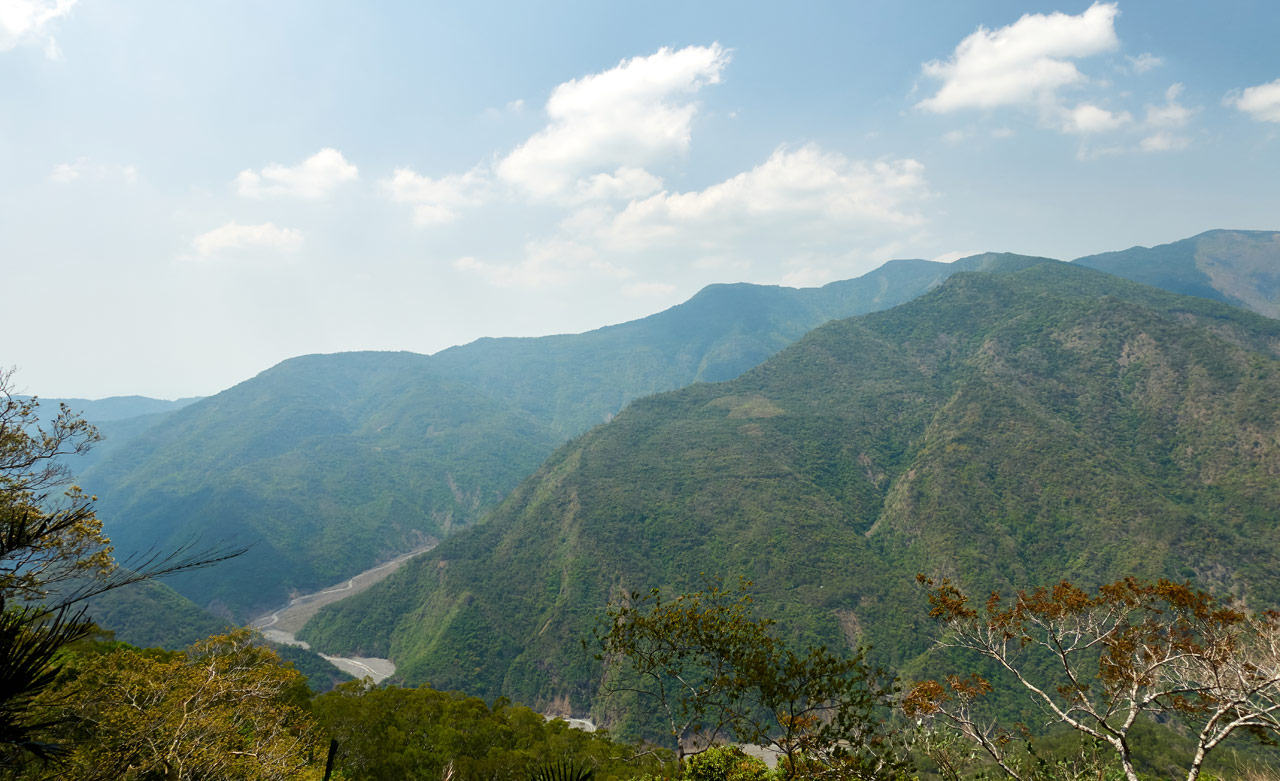 panoramic mountain scene with river below