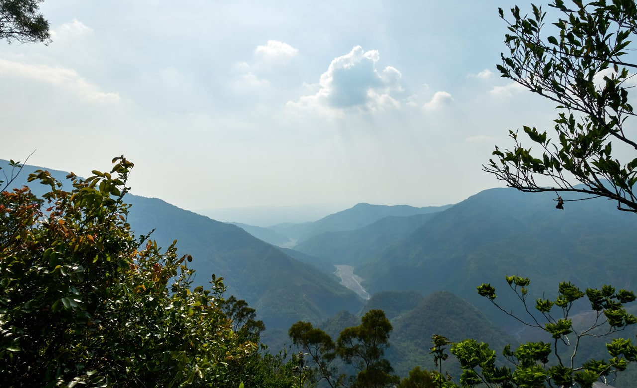 Panoramic view of mountains and river - hazy