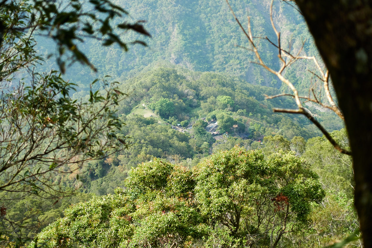 Zoomed in picture of small traditional aboriginal village below - many trees
