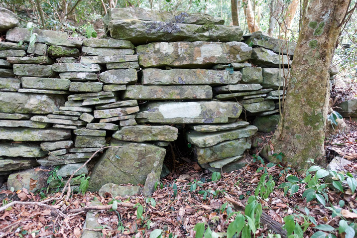 Stones stacked like a wall - hole at bottom