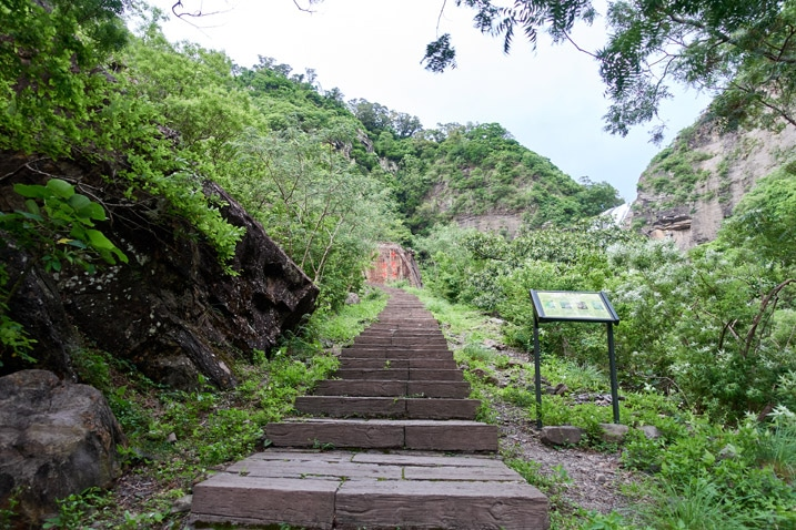 Stairs leading up mountain