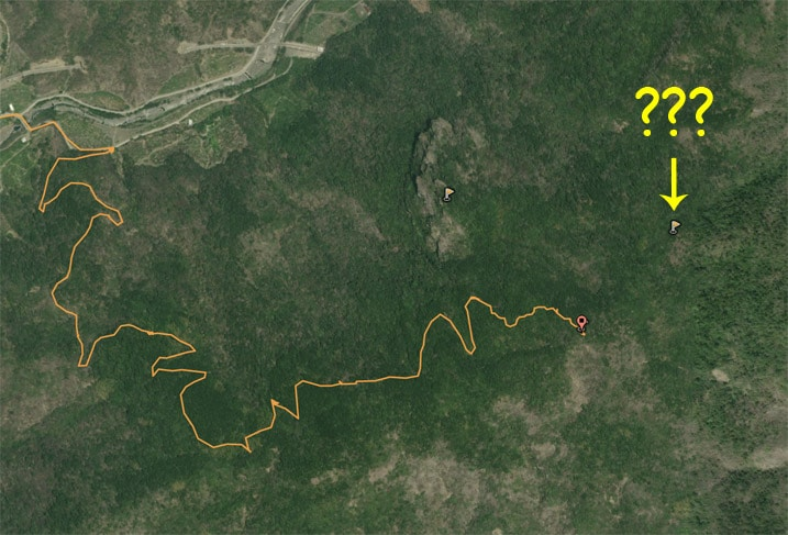 google satellite image with yellow GPX track and question marks near peak