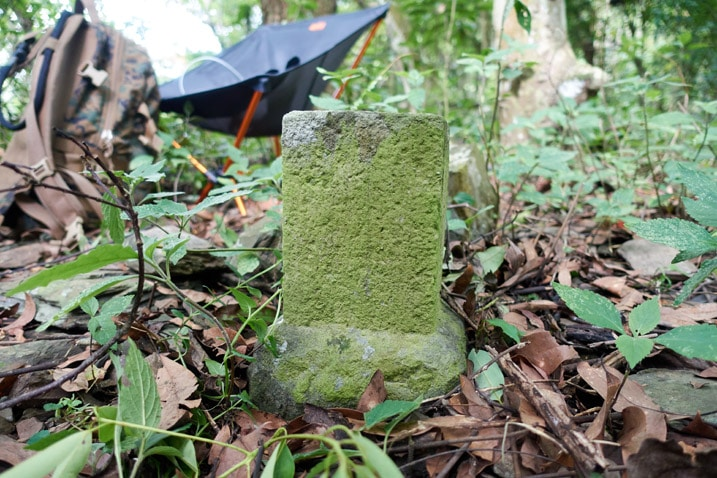 Closeup of triangulation stone - chair in background