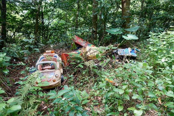 Old children's toys dumped in the mountains