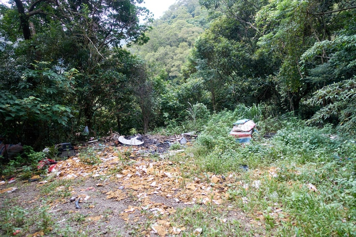 Open area with garbage dumped all over