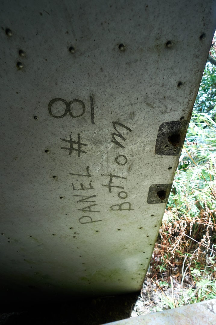 """Closeup of remains of Passive radio repeater - """"PANEL #8 Bottom"""" written on side"""