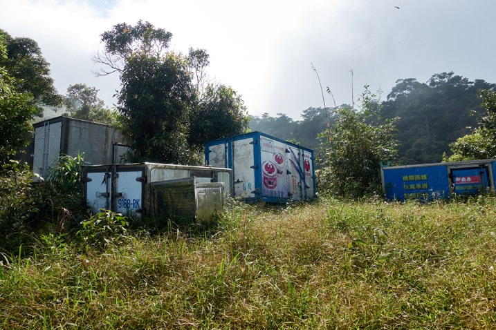 Several delivery truck trailers in an open field