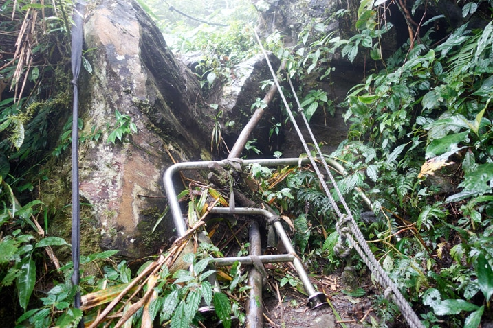 Lots of railings tied together as sort of steps to climb up rocks