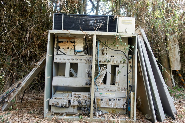 Old computer equipment discarded on mountain ridge