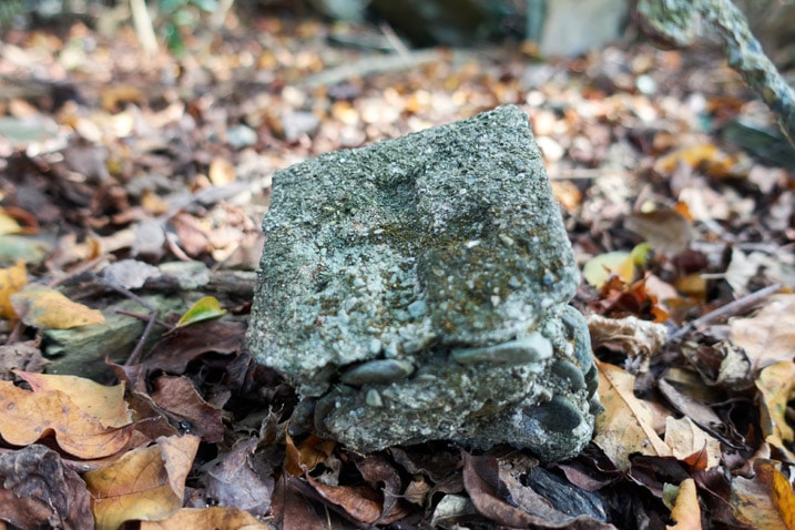 Top of stone marker with cross on top