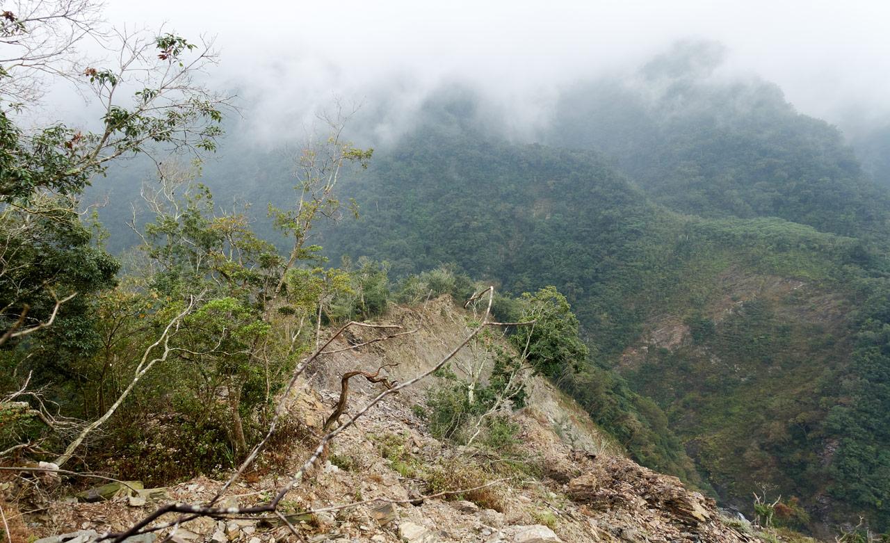 Mountain ridge - heavily eroded - landslide - green mountains in background