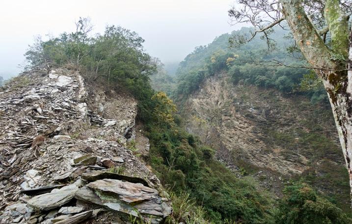 Rockslide on ridge - mountain in background - foggy