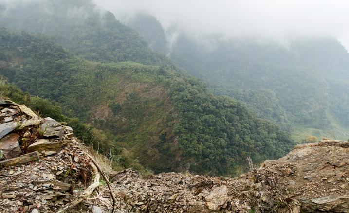 Looking down off the side of a crumbling ridge - mountains below