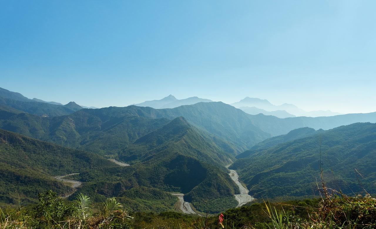 Mountain Landscape - blue sky - River below