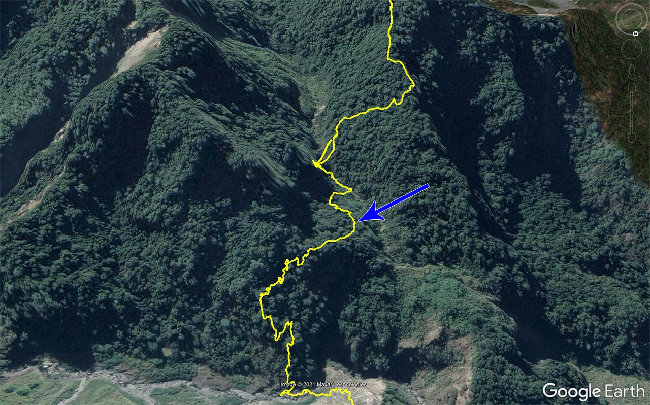 Google Earth map of mountains - yellow track and blue arrow
