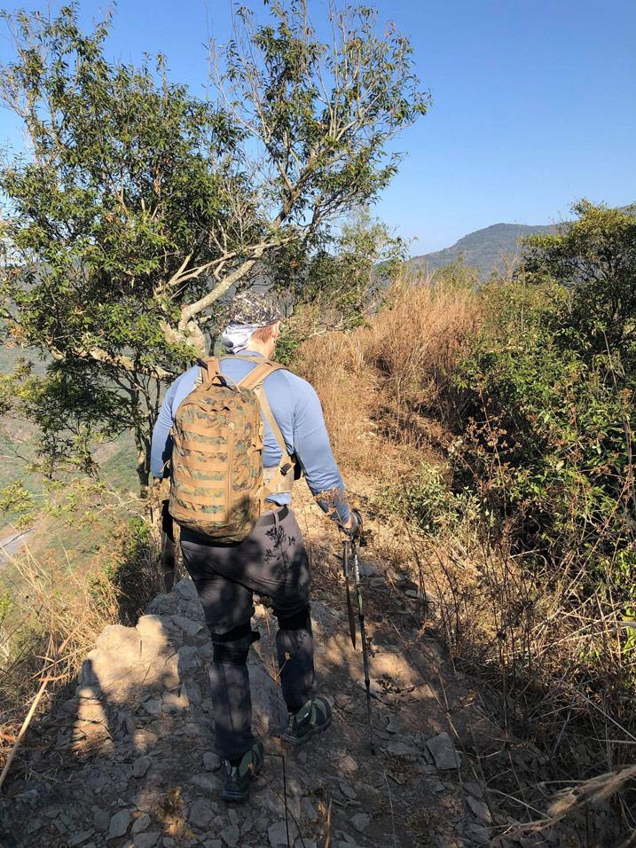 Hiker walking on mountain ridge