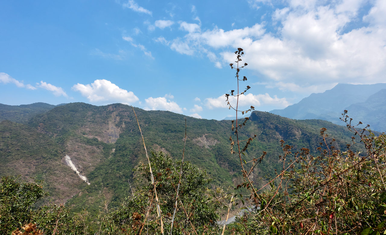 Panoramic view of mountains - blue sky and white clouds