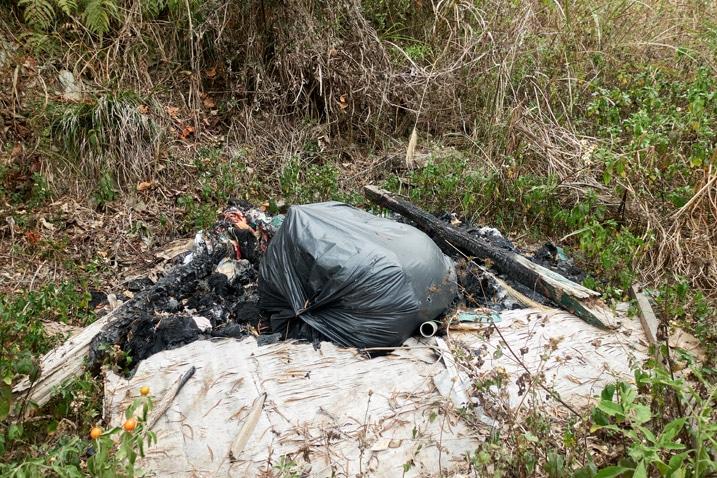 Pile of garbage half burned